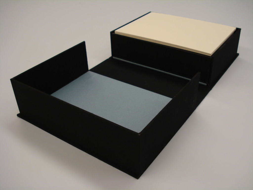 All of the materials fit neatly into a cloth-covered clamshell box allowing for easy shelf storage and transportation.