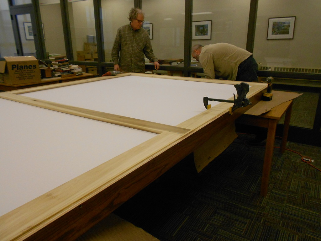 Skipping ahead a bit, voila!  Dust cover and additional frame supports in place.  We are now ready to hang!