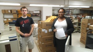Alex and Hyacinth unpacking a shipment from the commercial bindery