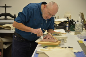 Senior conservation tech, Pat, working on one of the cradle arms.