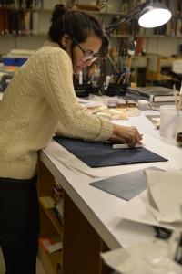 Our pre-program intern, Catarina, covering one of her cradle arms in navy Cialux.