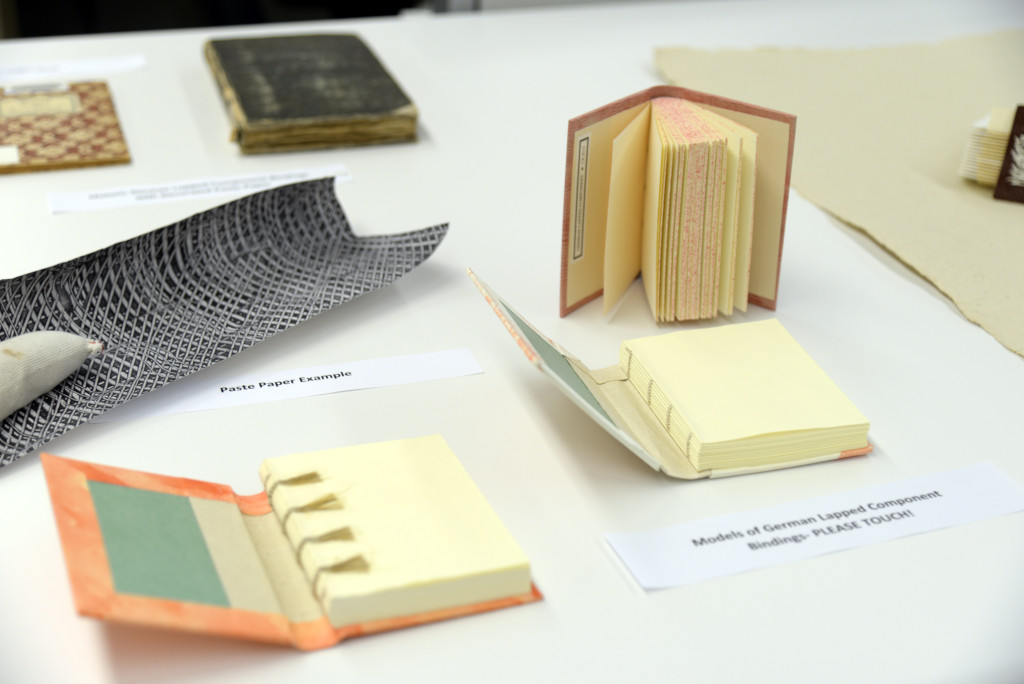 Book models and examples of paste paper.